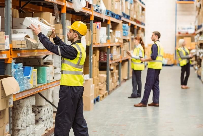 Employees in a warehouse pick orders.